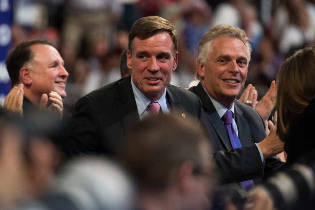 Warner (center) asked Wheeler about cybersecurity for IoT devices. (Rob Kunzig/Morning Consult)